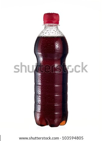 Bottle of soda cola with drops - stock photo
