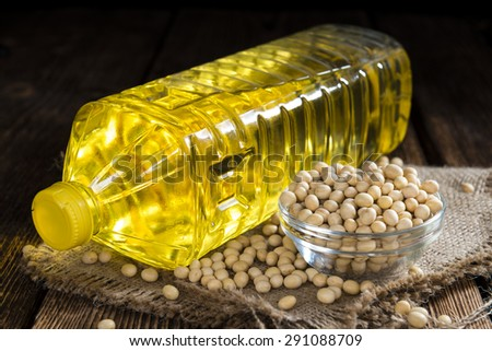 Bottle of Soy Oil on dark rustic wooden background - stock photo