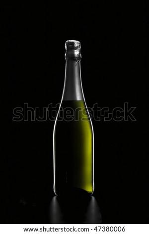 bottle of sparkling white wine on black - stock photo