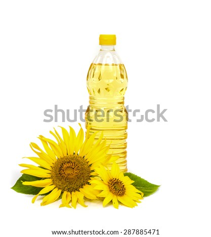 Bottle of sunflower oil with sunflower isolated on white background. - stock photo