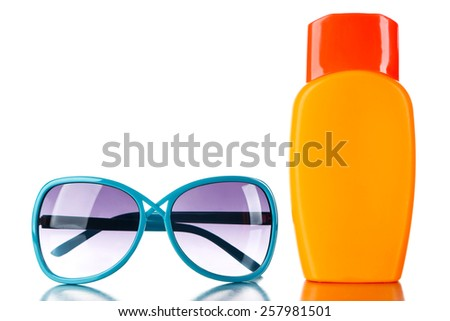 Bottle of suntan cream with sunglasses isolated on white - stock photo