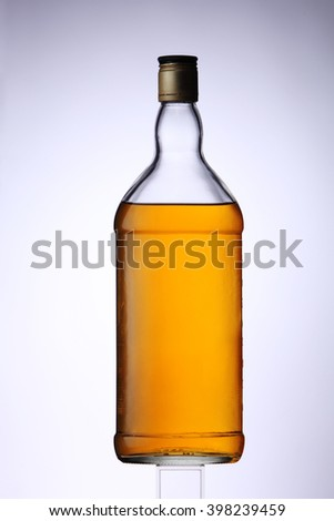 bottle of the golden whiskey bottle - stock photo