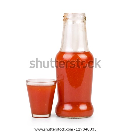 Bottle of tomato juice and glass, isolated on white background
