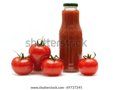 bottle of tomato juice and tomatoes