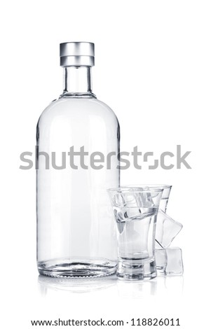 Bottle of vodka and shot glasses with ice. Isolated on white background - stock photo