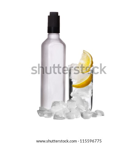 Bottle of vodka and wine glass with lemon and ice isolated on white - stock photo