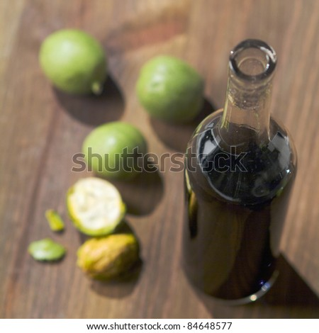 Bottle of walnut wine and fresh walnuts
