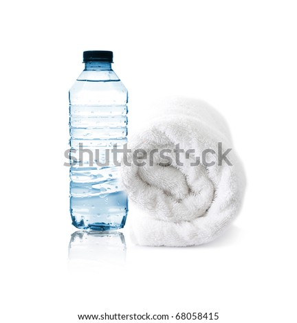 Bottle of water and towel - stock photo