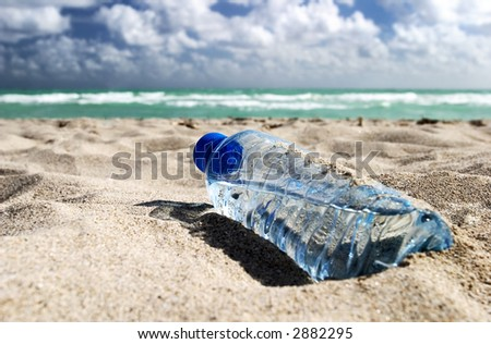 Bottle of water on the beach - stock photo