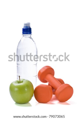 Bottle of water with fitness weights & apple isolated over white background