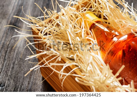 Bottle of whiskey in a wooden box. - stock photo