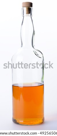 Bottle of whisky on white background - stock photo