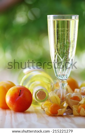 bottle of  white wine, glass and fruits - stock photo
