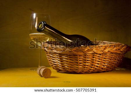 Bottle of white wine in a wicker basket