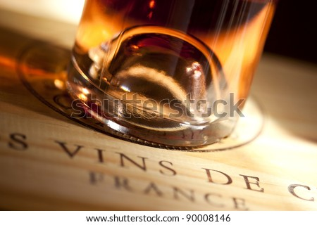 Bottle of white wine on a box of wine in a cellar - stock photo