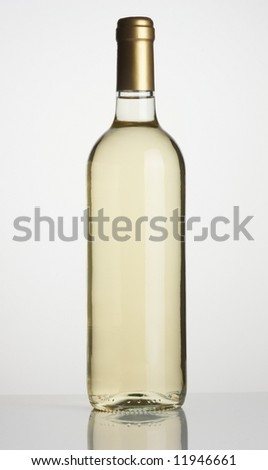 Bottle of white wine on white background - stock photo
