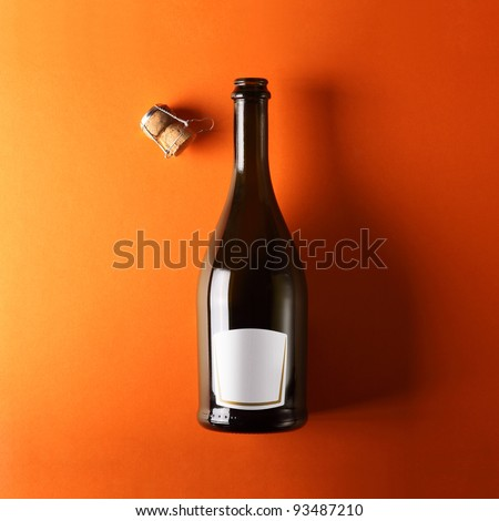 bottle of white wine, orange background