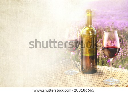 Bottle of wine against lavender landscape. - stock photo