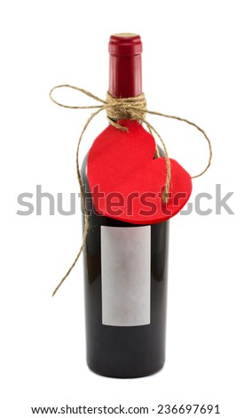 bottle of wine and a valentine isolated on white background - stock photo
