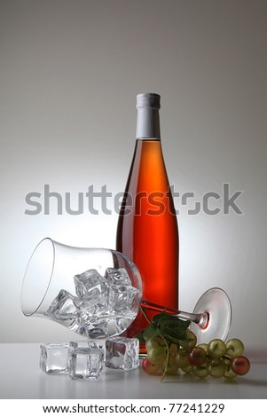 bottle of wine and glass of water with ice