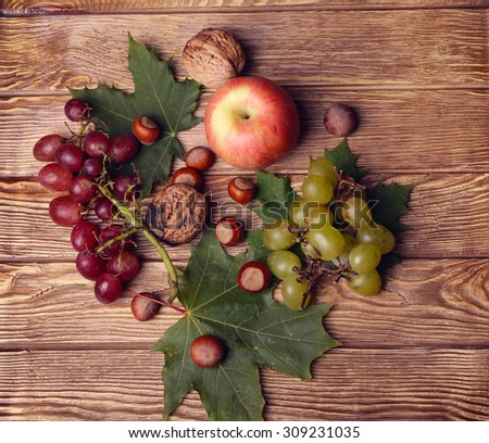 bottle of wine, glass, leaves, wooden - stock photo