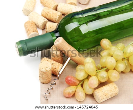 Bottle of wine, grapes and corks, isolated on white