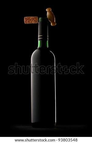 Bottle of wine in black - stock photo