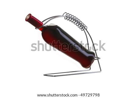 bottle of wine in holder - stock photo