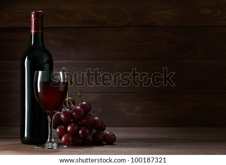 bottle of wine in the cellar of  wooden - stock photo