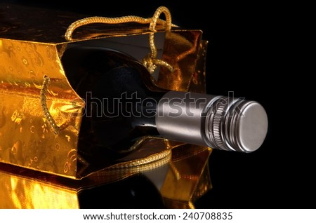 bottle of wine in the gift bag - stock photo