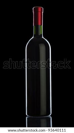 bottle of wine isolated on black background - stock photo