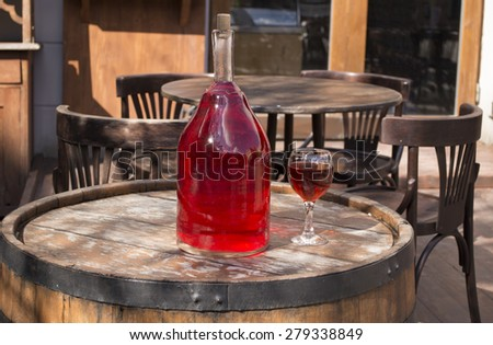 bottle of wine on a barrel in the restaurant. - stock photo
