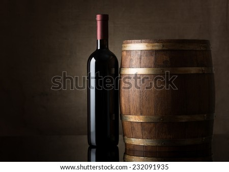 Bottle of wine on an old  barrel - stock photo