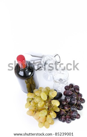Bottle of wine with aperitive, glasses and grapes isolated in white