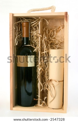 bottle of wine with brown label and a scroll in wooden box - stock photo