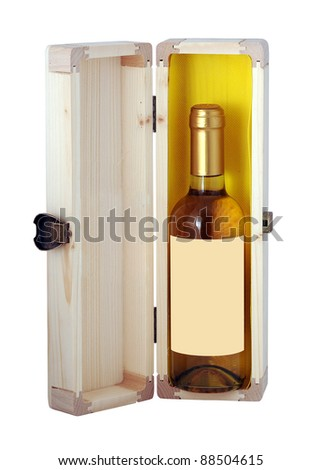 Bottle of wine with empty label in a wooden box on white background