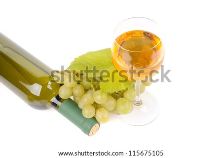 bottle of wine with glass and green grapes - stock photo