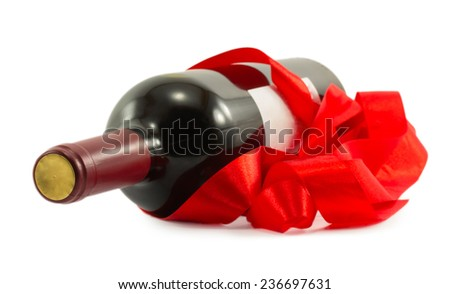 bottle of wine with red ribbon isolated on white background - stock photo