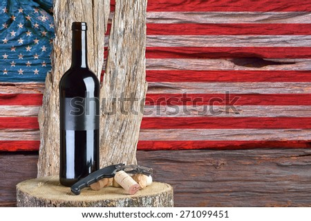 bottle of wine with the United States flag in the background - stock photo