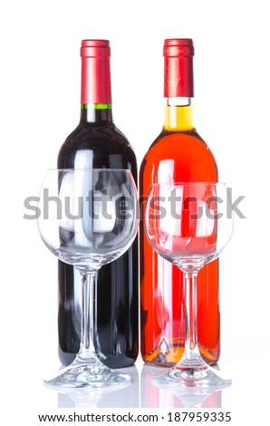 Bottle of wine with two glasses, isolated on white