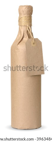 bottle of wine wrapped in kraft paper with a price tag isolated with clipping paths - stock photo