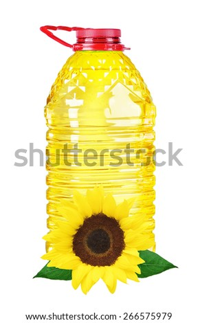 bottle oil plastic big and sunflower on white background - stock photo