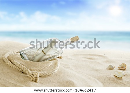 Bottle on the beach - stock photo