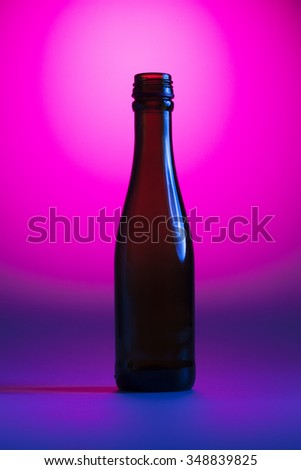 Bottle on the pink and blue background - stock photo