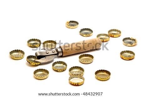 Bottle opener and cork from beer bottles on a white background - stock photo