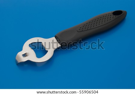 Bottle opener isolated on the blue background. - stock photo