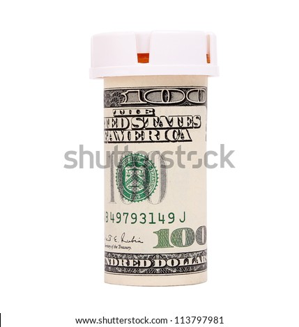 bottle pills wrapped in money isolated on white
