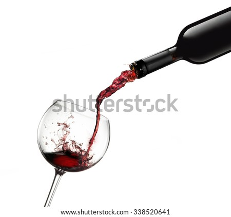 Bottle pouring red wine into a glass with splashes, isolated on white - stock photo