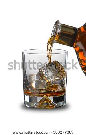 Bottle Pouring Whiskey To Glass - stock photo