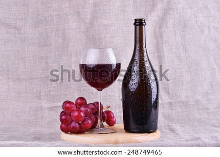 Bottle, red wine in glass with grapes isolated on white background - stock photo